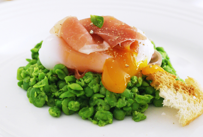 Sous vide Goose egg on a pea and mint nest with prosciutto