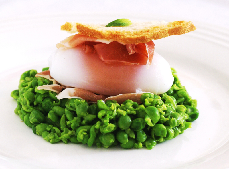 Delicious goose egg recipe on pea nest with prosciutto